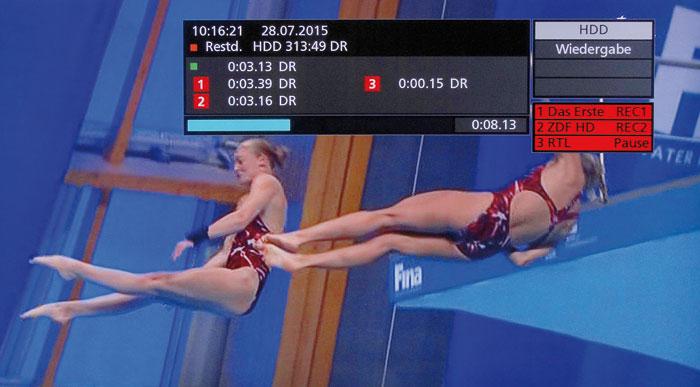Bis zu drei Sender lassen sich parallel aufnehmen. Der Infoschirm kennzeichnet laufende Aufnahmen rot.