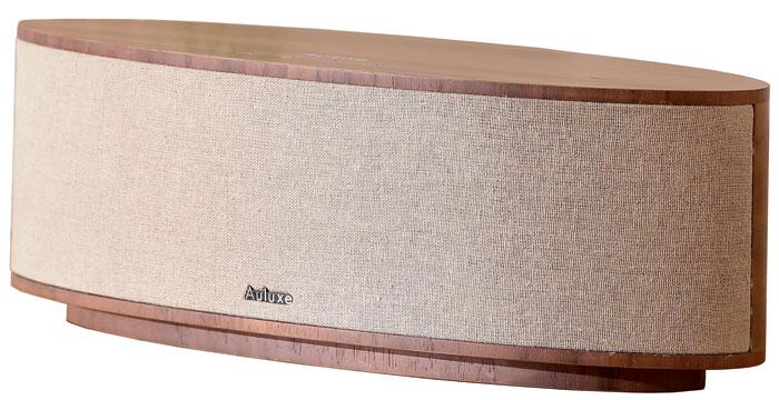 Elegant: Der Bluetooth-Lautsprecher besticht optisch durch Echtholz-Furnier und Bespannung aus Leinen.