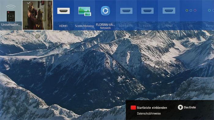 Ansehnliche Eingangswahl: Die verfügbaren Quellen werden auf Tastendruck am oberen Bildschirmrand eingeblendet. Darin sind auch die Netzwerkgeräte erfasst.