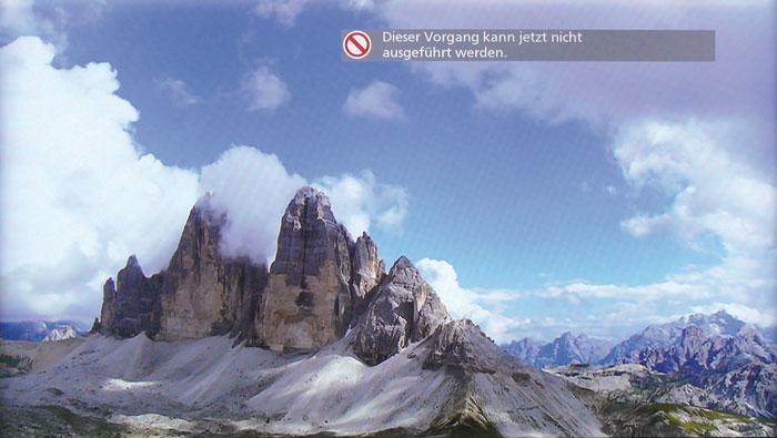 Bild 3: Verglichen mit dem Original (oben) fällt jedoch auf, dass Details wie die Abstufungen in den Wolken verloren gehen.