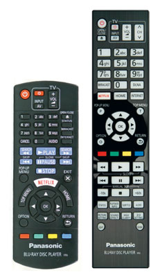 Zwei-Klassen-Gesellschaft: Dem Top-Modell UB900 liegt eine edle Fernbedienung mit beleuchteten Tasten bei (rechts), Käufer des UB704 bekommen nur den Standard-Signalgeber der Einstiegsgeräte.