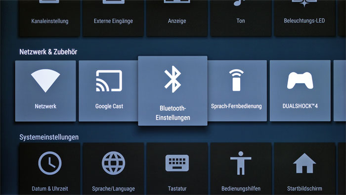 Im Systemmenü lassen sich alle technsichen Einstellungen vornehmen. Hier können beispielsweise Bluetooth-Geräte oder der PlayStation-Controller gekoppelt werden.