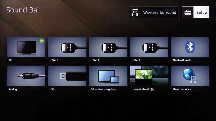 """""""Home""""-Menü: Von hier aus gelangt man zu allen Funktionen der Soundbar; auch Quellenwahl und Netzwerk-Dienste sind aufrufbar."""